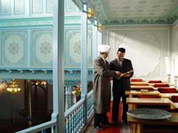 The head of the madrassah's library Murod Gulyamov (right)